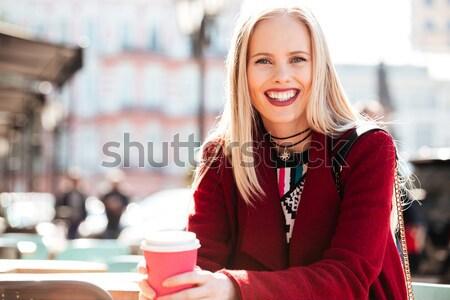 Elképesztő fiatal kaukázusi nő beszél telefon Stock fotó © deandrobot