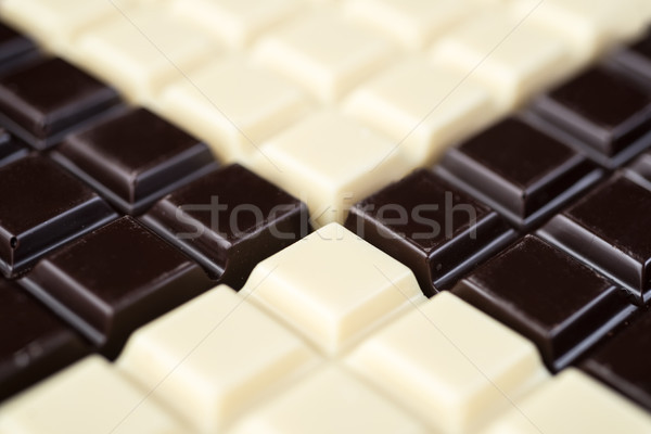 Stock photo: Dark and white chocolate bars combined together