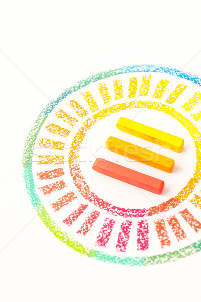 Cropped photo of circle drawn with colorful pastel chalks Stock photo © deandrobot