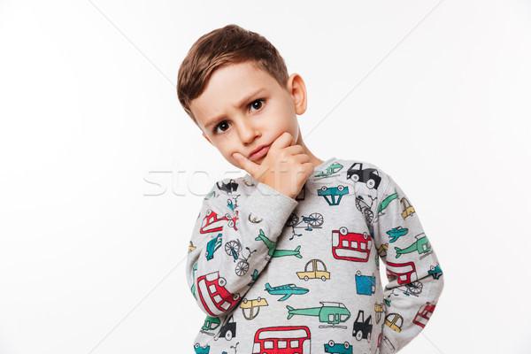 Portrait of a pensive cute little kid Stock photo © deandrobot