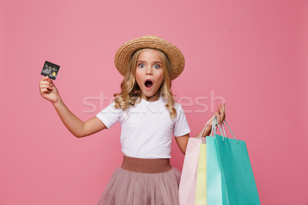 Portrait of a shocked little girl in hat and skirt Stock photo © deandrobot