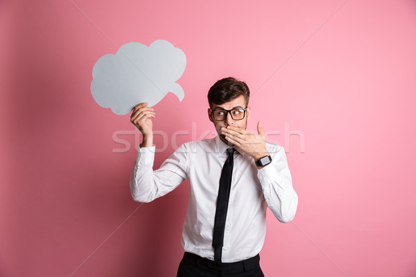 Portrait of a shy embarrassed man in white shirt Stock photo © deandrobot