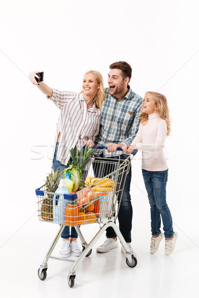 Full length portrait of a happy family Stock photo © deandrobot