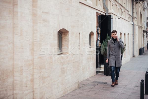 写真 エレガントな 男性 コート 袋 手 ストックフォト © deandrobot