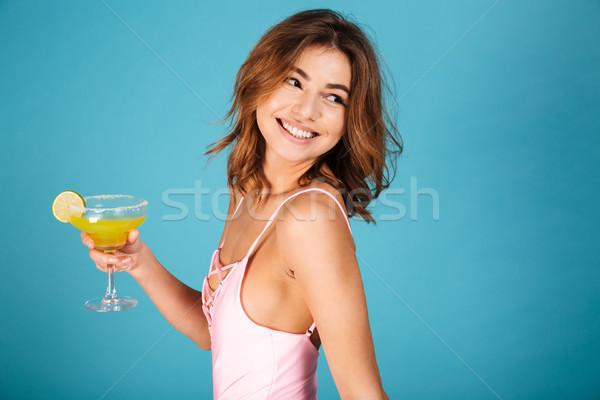 портрет улыбаясь девушки купальник коктейль Сток-фото © deandrobot