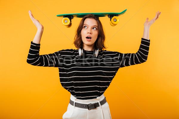 портрет довольно девушки скейтборде голову Сток-фото © deandrobot
