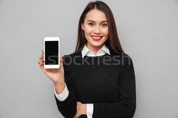 Sorridente asiático mulher negócio roupa Foto stock © deandrobot