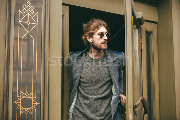 Portrait of a confident bearded man Stock photo © deandrobot