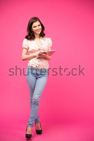 Full length portrait of a pretty young girl holding copy space Stock photo © deandrobot