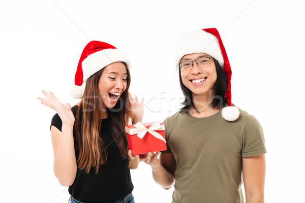 肖像 満足した アジア 男 クリスマス 帽子 ストックフォト © deandrobot