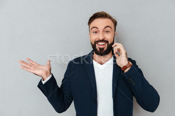 Boldog szakállas férfi üzlet ruházat beszél Stock fotó © deandrobot