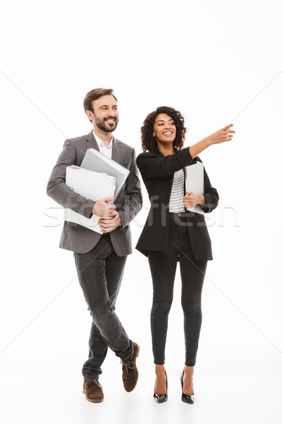 Full length portrait of a happy multiracial business couple Stock photo © deandrobot