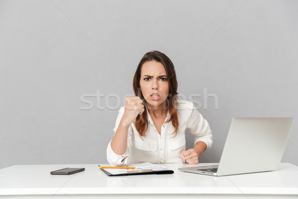 Portrait of a furious young business woman Stock photo © deandrobot
