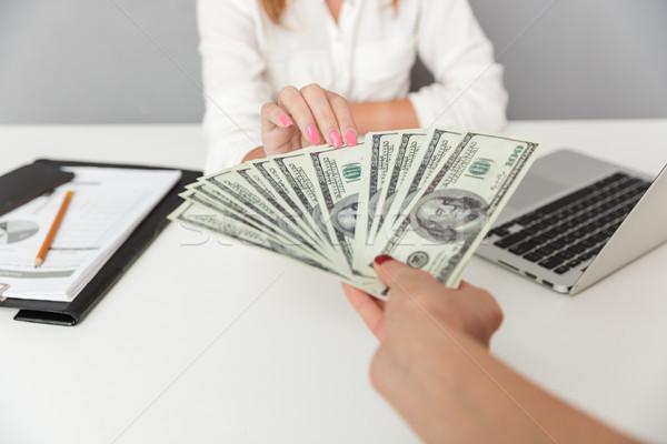 Close up portrait of hand holding cash Stock photo © deandrobot
