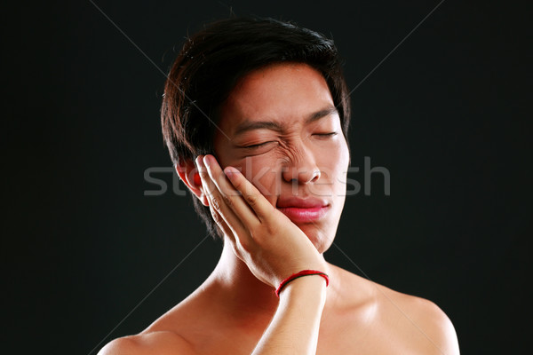 Closeup portrait of a Young Asian man with toothache Stock photo © deandrobot