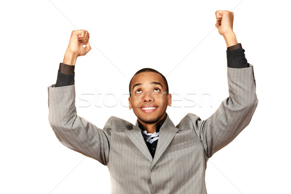 Young african-american businessman celebrates his victory isolated on white background Stock photo © deandrobot