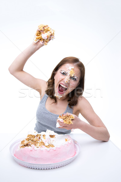 Angry young woman wants to throw cake into the camera Stock photo © deandrobot
