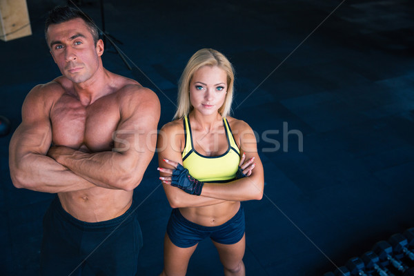 Group of a man and woman in crossfit gym Stock photo © deandrobot