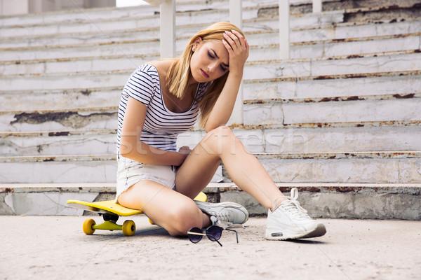 Genç kadın patenci baş ağrısı açık havada kız Stok fotoğraf © deandrobot