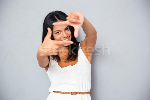 Kadın çerçeve jest mutlu genç kadın Stok fotoğraf © deandrobot