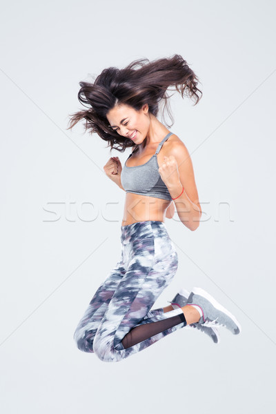 Stock photo: Cheerful fitness woman jumping