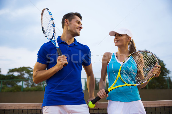 Tennis players talking at the court Stock photo © deandrobot