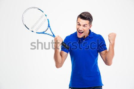 Pensive man in sports wear and tennis racket looking away Stock photo © deandrobot