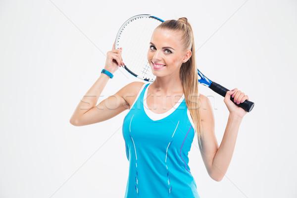 Smiling woman holding tennis racket  Stock photo © deandrobot