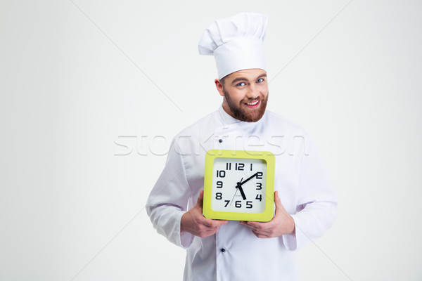 Happy male chef cook holding wall clock  Stock photo © deandrobot