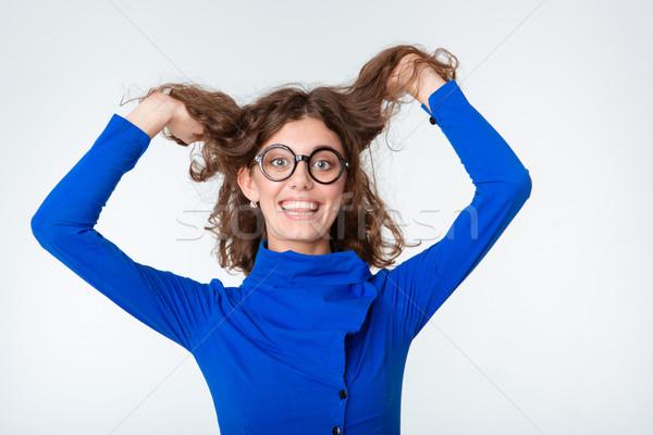 Drôle femme verres regarder caméra portrait Photo stock © deandrobot
