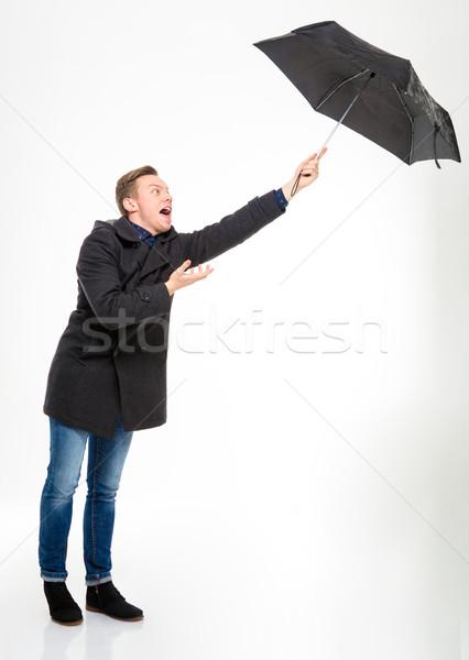 Angstig jonge man paraplu vliegen weg Stockfoto © deandrobot