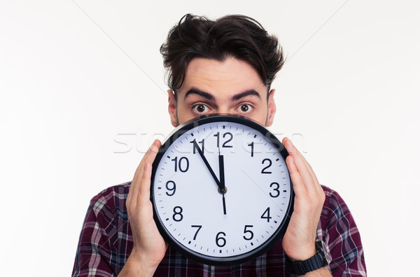 Man covering her face with wall clock  Stock photo © deandrobot