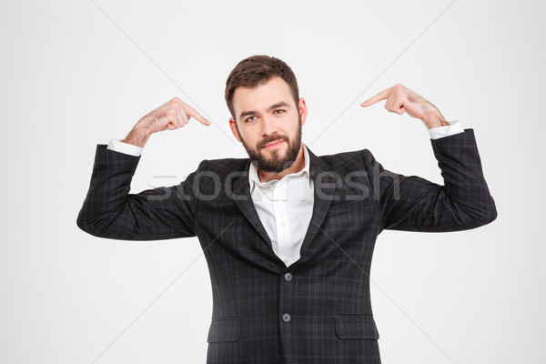 Proud businessman pointing fingers at herself Stock photo © deandrobot