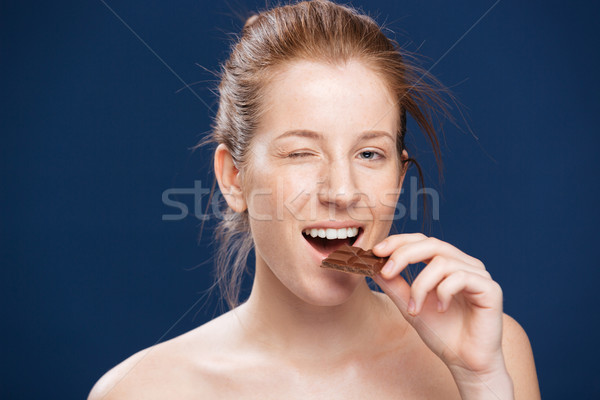 Woman eating chocolate Stock photo © deandrobot