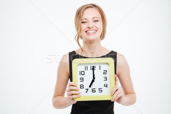 Mutlu sevimli genç kadın büyük saat Stok fotoğraf © deandrobot