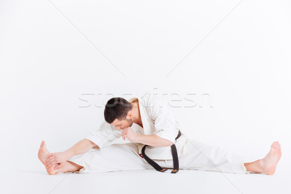 Man in kimono limbering up Stock photo © deandrobot