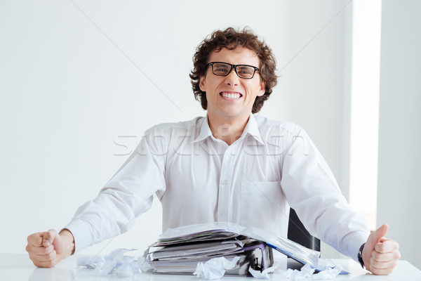 Anger businessman sitting at the table Stock photo © deandrobot