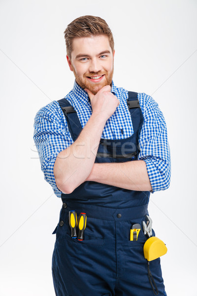 Happy thoughtful male builder looking at camera Stock photo © deandrobot