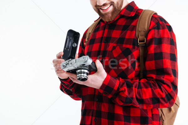 Cropped image of a man holding retro camera Stock photo © deandrobot