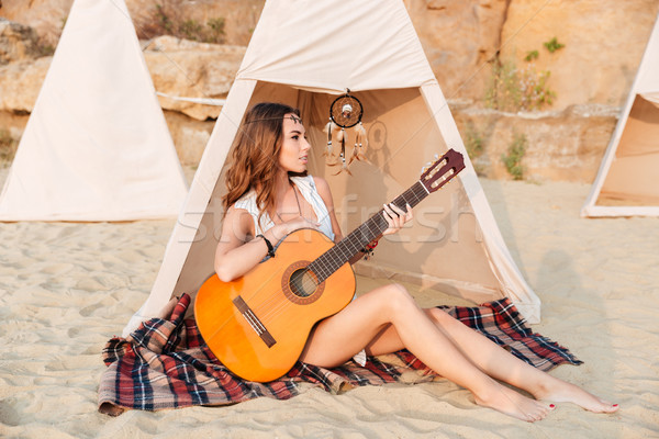 hippie girl with guitar