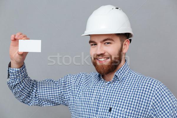 Boldog szakállas építész tart copy space névjegy Stock fotó © deandrobot