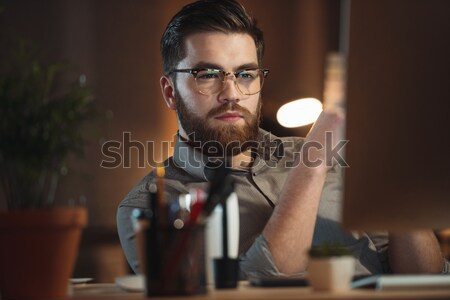 Tired designer working late at night. Stock photo © deandrobot