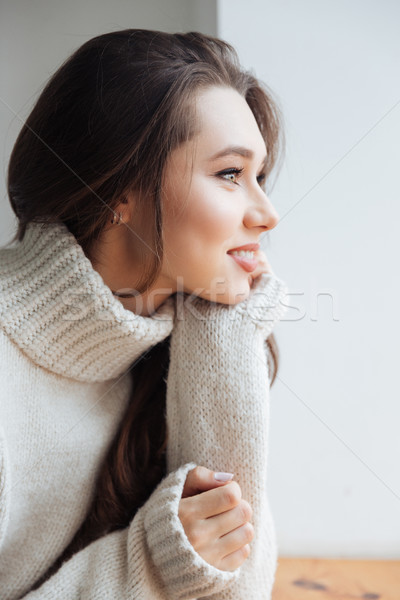 Side view of model in sweater Stock photo © deandrobot