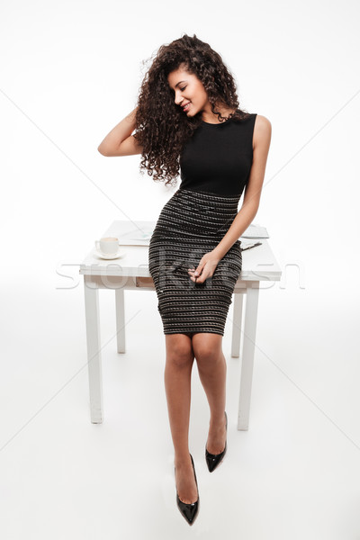 Incredible young curly african lady posing over white background Stock photo © deandrobot