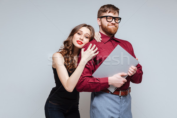 Pretty Woman from back of Male nerd Stock photo © deandrobot