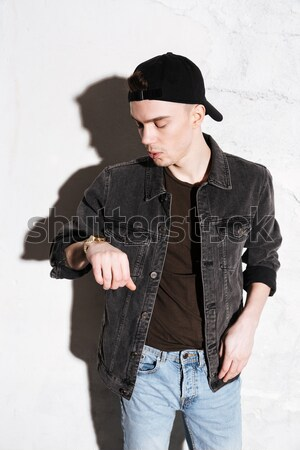 Hipster holding his snap back Stock photo © deandrobot