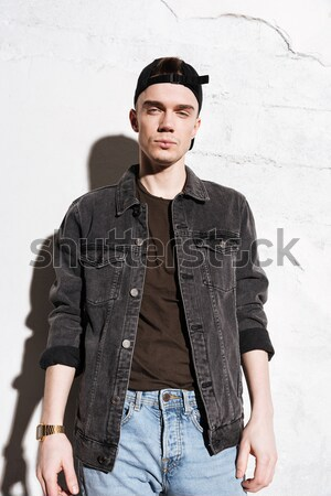 Vertical image of Hipster asks for money in snap back Stock photo © deandrobot