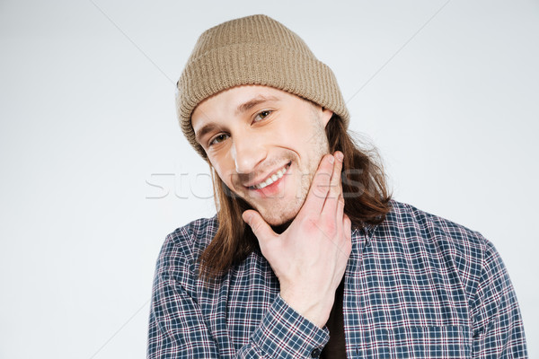 Close up portrait of Smiling hipster holding chin Stock photo © deandrobot