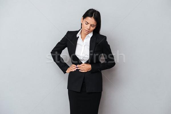 Donna d'affari addominale dolore suit Foto d'archivio © deandrobot