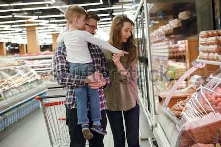Fiatal család pult tojások boldog áll Stock fotó © deandrobot